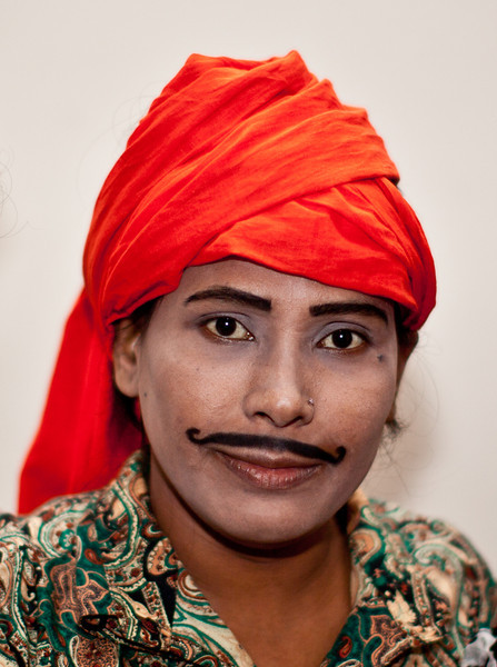 A girl who is dressed up to make fun of men. She is ready to enter the stage at a teater in Dhaka.