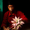A man selling lotus flowers in Old Dhaka.