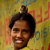 A girl posing with a chicken. She lives in a slum in Banani, Dhaka.