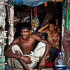 Husband and wife at home on the street in Saidabad, Dhaka.
