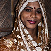 A transgender who collects money in a slum area.
