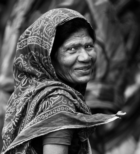 A day labourer waiting to be picked up in the morning on the street in Khulna.