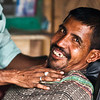 A man enjoying Friday morning at the barber in a village in Manikgunj.