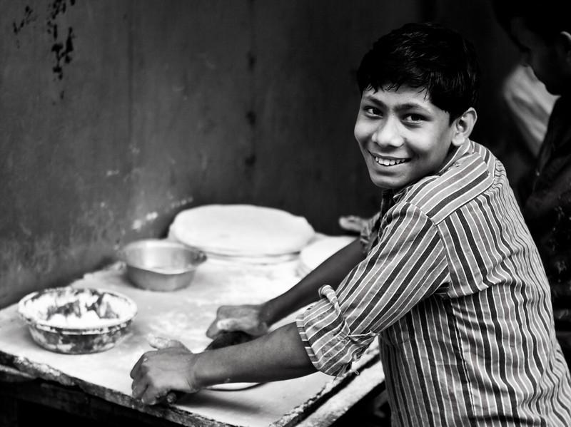 A boy making bread in Gulshan. In Bangladesh the fresh bread is just superb.