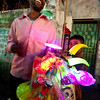A man selling Chinese plastic toys in Old Dhaka.