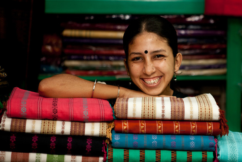 A Tripura woman selling weavings in North-Eastern Bangladesh.