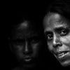 Women in the doorstep of their home in a slum in Gulshan, Dhaka.