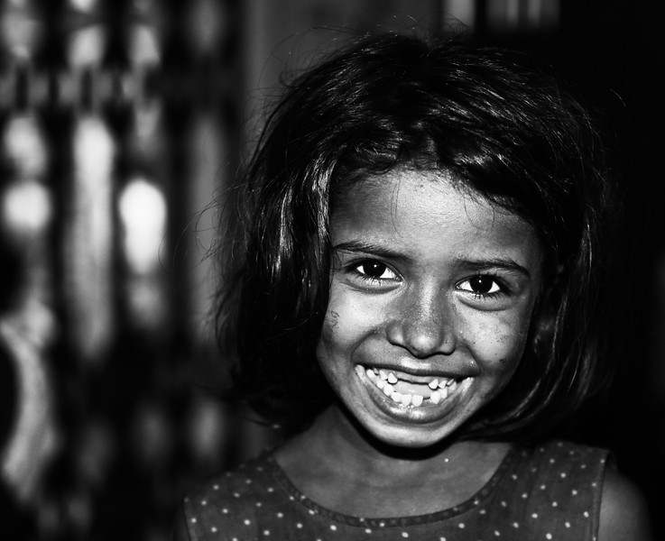 A girl waiting for relatives in Dhaka court.