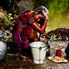 A woman taking an afternoon bath in a village in Bagerhat.