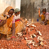 Women who are working along the highway outside Chittagong breaking bricks. A very common job for women and children.