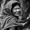 A female day labourer waiting to be picked up in the morning on the street in Khulna.