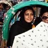 Two women waiting to pass a crossing in Dhaka mega city.