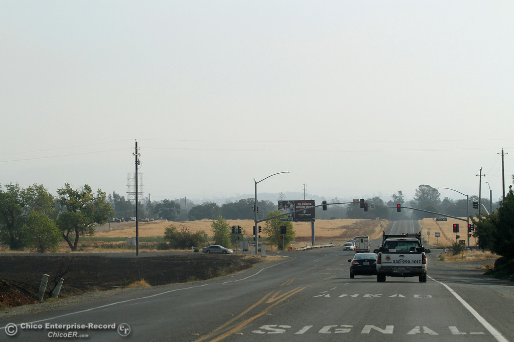 . Smoke from multiple fires fills the skies Tuesday, Oct. 10, 2017, on Ophir Road in Oroville, California, after the La Porte Fire ripped through the unincorporated Butte County community of Bangor, California. (Dan Reidel -- Mercury-Register)