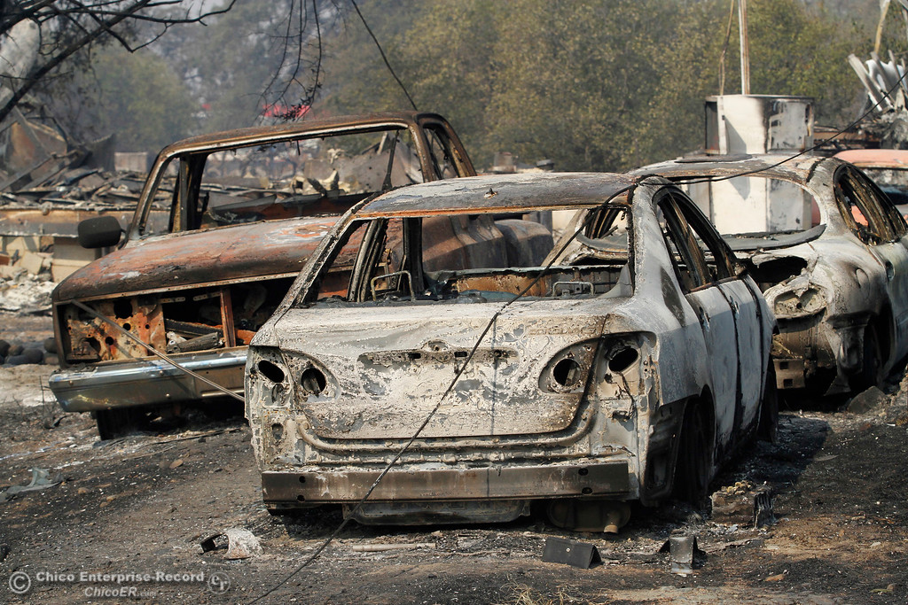 . Several vehicles are seen Tuesday, Oct. 10, 2017, resting on their rims after the La Porte Fire scorched paint and melted tires Sunday night in Bangor, California. (Dan Reidel -- Mercury-Register)