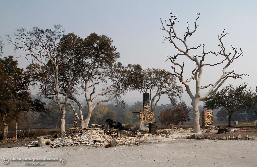 . The charred and smoldering remains of a home on the 200 block of Los Verjeles Road on Tuesday, Oct. 10, 2017, in Bangor, California, after the La Porte Fire ripped through the unincorporated Butte County community. (Dan Reidel -- Mercury-Register)