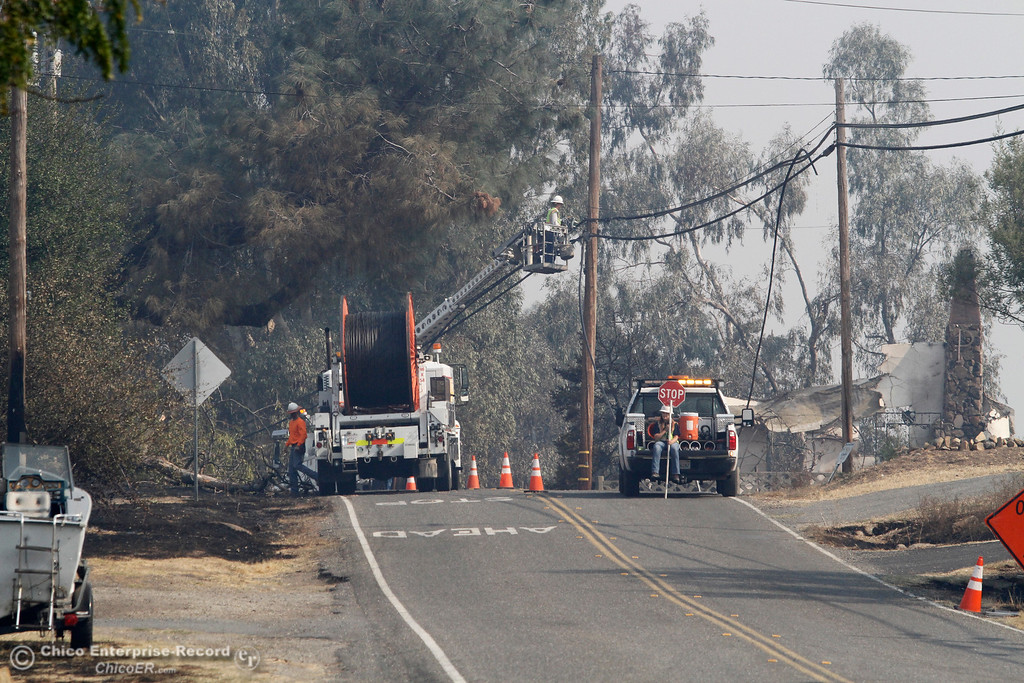 . An AT&T crew replaces fiber optic cable Tuesday, Oct. 10, 2017, along La Porte Road in Bangor, California. The La Porte Fire ripped through the unincorporated Butte County community, destroying building, including the one behind the crew on the 5700 block of La Porte Road. (Dan Reidel -- Mercury-Register)