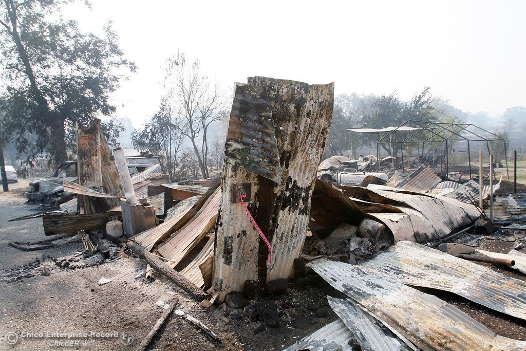 . Two ruined buildings and burnt vehicles Tuesday, Oct. 10, 2017, on the 7500 block of Oro Bangor Highway in Bangor, California, after the La Porte Fire ripped through the unincorporated Butte County community. (Dan Reidel -- Mercury-Register)