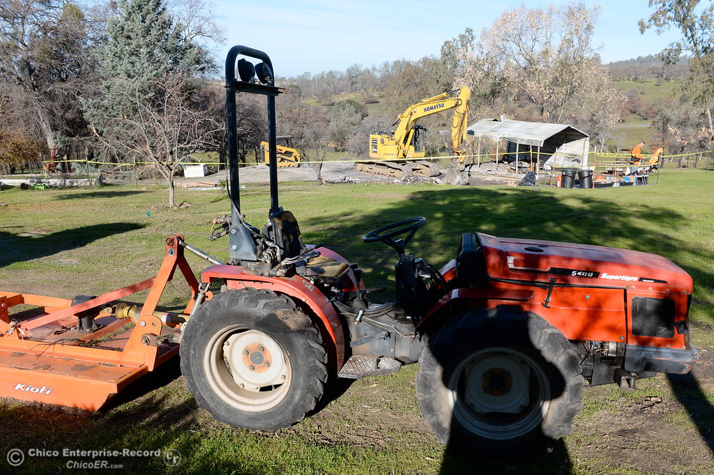 . A tractor that was damaged during the fire appears to still be functional as State and Federal agencies help clean up debris at the Bangor Ranch and Vinyard following the La Porte Fire in Bangor, Calif. Wed. Dec. 13, 2017. (Bill Husa -- Enterprise-Record)