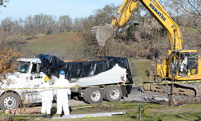 State and Federal agencies help clean up debris at the Bangor Ranch and Vinyard following the La Porte Fire in Bangor, Calif. Wed. Dec. 13, 2017. (Bill Husa -- Enterprise-Record)