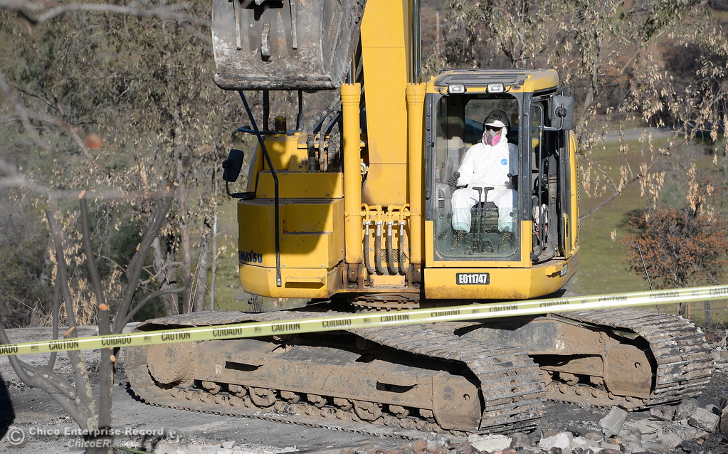 . Scott Feri, Foreman/Superintendant for Steelhead Constructors Inc. out of Redding operates an excavator as State and Federal agencies help clean up debris at the Bangor Ranch and Vinyard following the La Porte Fire in Bangor, Calif. Wed. Dec. 13, 2017. (Bill Husa -- Enterprise-Record)