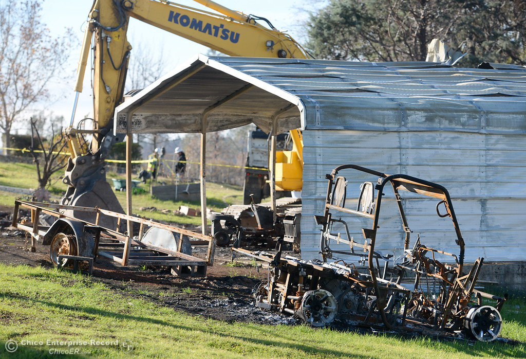 . State and Federal agencies help clean up debris at the Bangor Ranch and Vinyard following the La Porte Fire in Bangor, Calif. Wed. Dec. 13, 2017. (Bill Husa -- Enterprise-Record)