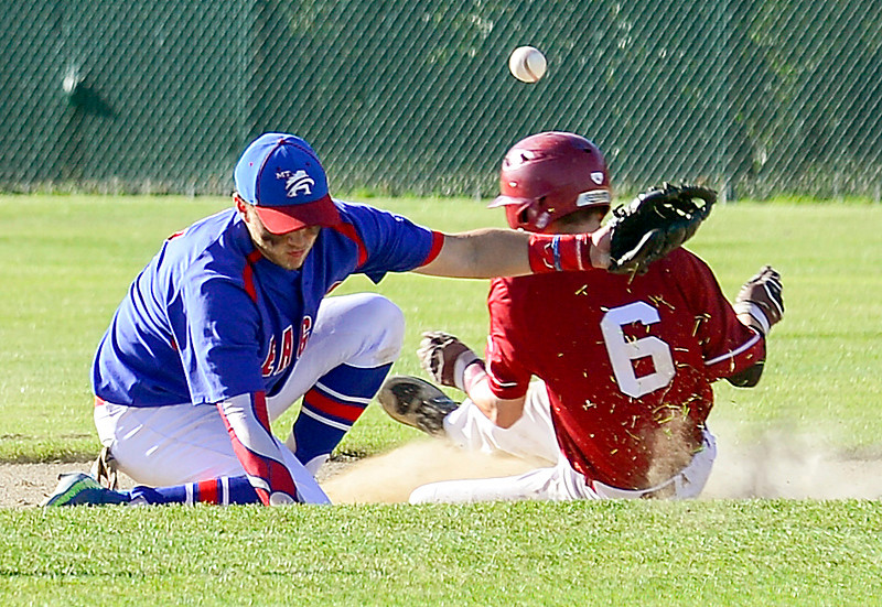 Bangor's Tyler Parker is safe at second after the ball goes off the glove of Mt. Ararat's Nick Merril's in the fourth inning of Wednesday's Class A North title game in Augusta.