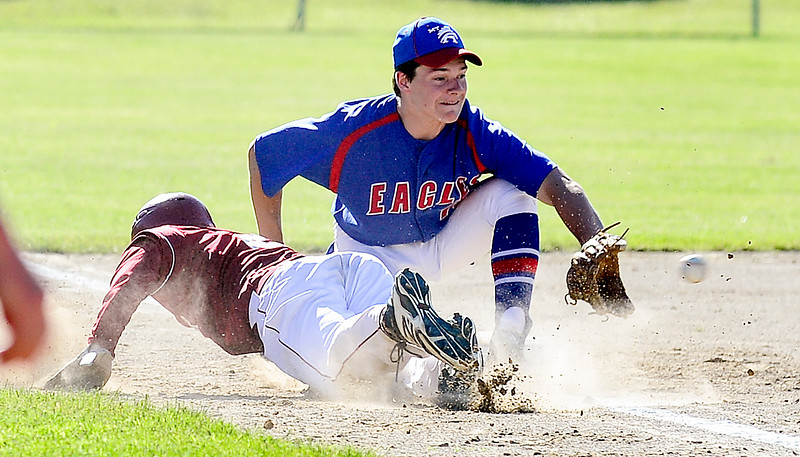 Bangor's Gary Farnham doesn't make it back the third base past the defenses of Mt. Ararat's Nate Leslie during a double play Wednesday in the Class A Regional State Championship at Augusta's Morton Field. The Rams won 3-0.  <br /> Amber Waterman Thomas