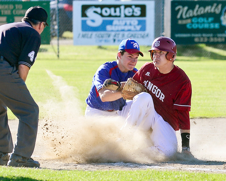 Zach Cowperthwaite of Bangor is tagged out at third base by Mt. Ararat's Nate Leslie during the fourth inning Wednesday at the Class A North baseball championship. The Rams won 3-0.