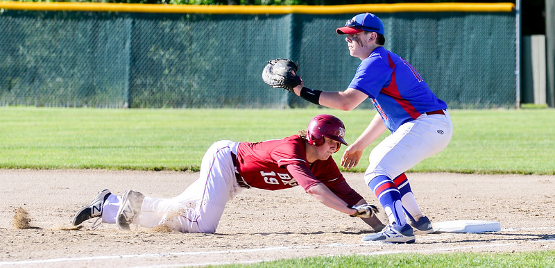 Bangor's Peter Kemble scrambles back to first past Mt. Ararat's Sam Alexander during an attempted pick-off in the top of the fourth inning Wednesday in Augusta. The Bangor Rams went on to win the Regional Class A Championship 3-0.  <br /> Amber Waterman Thomas