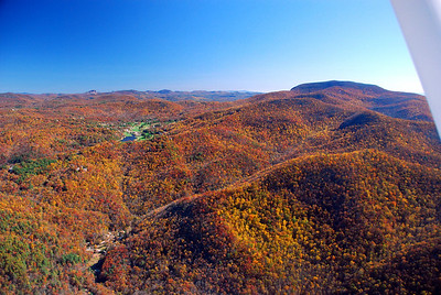 Northeast Georgia mountains in their fall color. Sky Valley resort visible to the left, Rabun Bald, the second tallest mountain in Georgia, to the right.