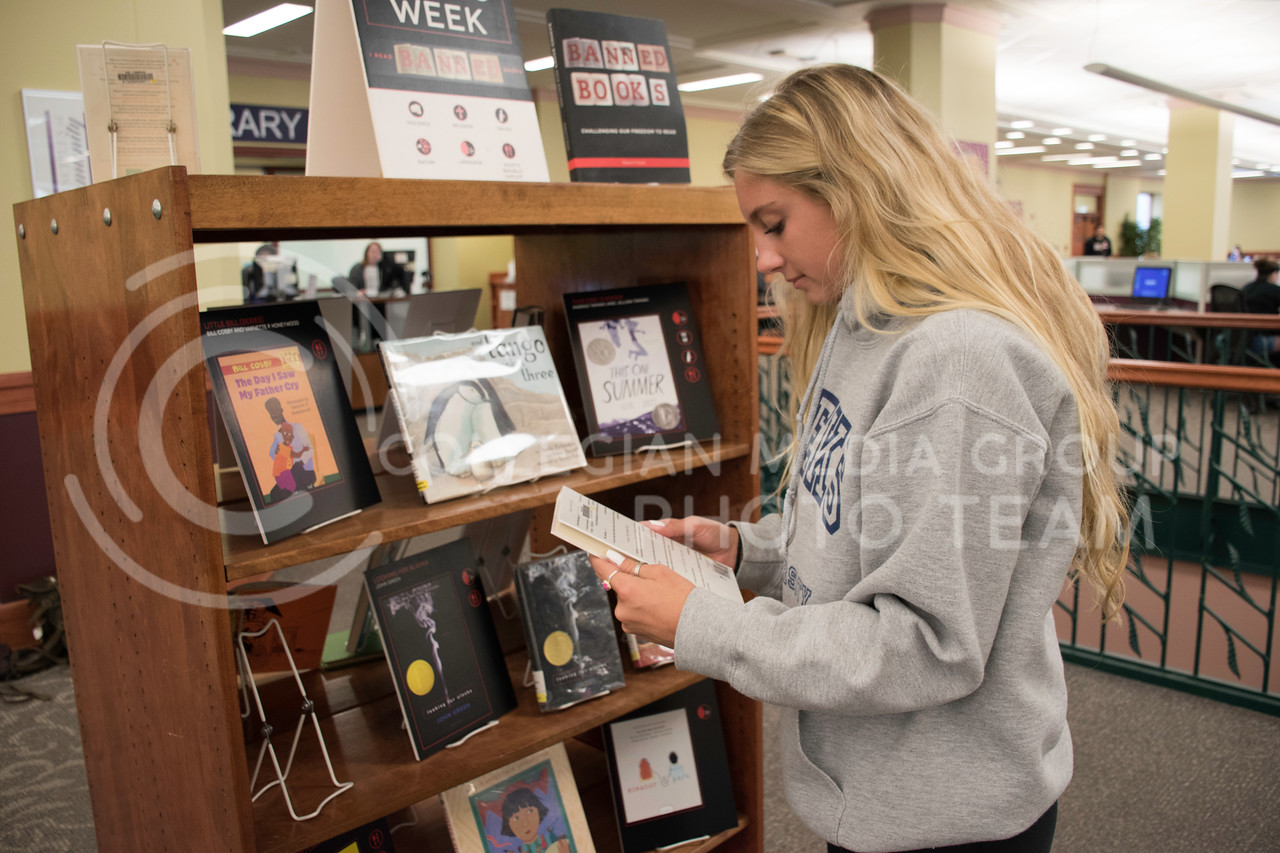 Peyton Weeks, a sophomore at Kansas State studying Life Science, checks out the Banned Books display in Hale Library on Sept. 28, 2017. (Olivia Bergmeier | Collegian Media Group)