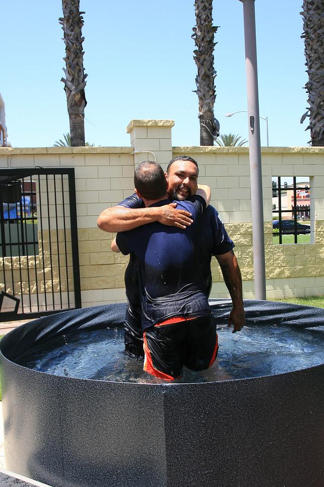 Stuart Lopez and Pastor Jeremiah Goley after Stuart's baptism on Sunday August 5, 2012
