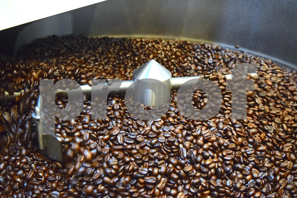 Coffee beans are roasted in Jack Cress' small coffee shop, inside a back room of Cresswood Shredding Machinery in Cortland. Cress roasts and creates his own specialty coffee for his own brand, Barb City Roasters.