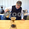 Jack Cress adds boiling water to coffee grounds while brewing coffee using the pour over method. Cress' specialty coffee brand, Barb City Roasters, is sold by the bag at Inboden's Meat Market, 1106 N. First St. in DeKalb, and sold brewed by the cup at Common Grounds, 50 E. Lincoln Highway in DeKalb.