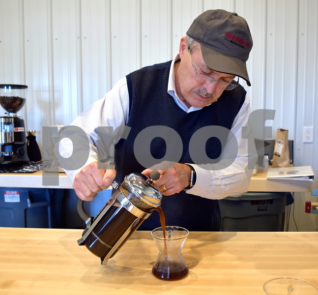 Jack Cress pours out coffee that was created using the French press method of brewing coffee. Cress' specialty coffee brand, Barb City Roasters, is sold by the bag at Inboden's Meat Market, 1106 N. First St. in DeKalb, and sold brewed by the cup at Common Grounds, 50 E. Lincoln Highway in DeKalb.
