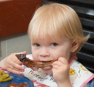 St. Louis girl eat ing Baby Back