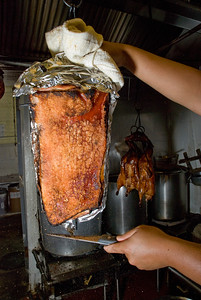 Ths skin side of the pork bellies show the stippling characteristic of Hong Kong style cooking.