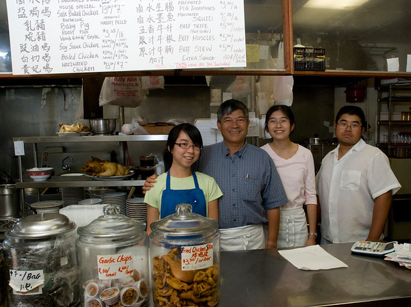 "Sun Wah Bar-B-Q Restaurant has been an Uptown Chicago destination since 1987. Sun Wah, which means New China, is very much a family venture. Founder and owner Eric Cheng is second from the left. To his left is his niece, Carol Mak, and to his right is his eldest daughter Kelly, and third child, Michael. Not show in Mr. Cheng's wife Lynda, and his youngest child, Laura, a culinary school graduate. Another sister, Cindy, is not involved in the restaurant, but her infant daughter is already a foodie. At age one, she won't eat anything that isn't flavorful.<br /> <br /> Eric Cheng learned Chinese barbecue, in Guangdong Province in Southern China, home of Cantonese cuisine. He fled Mao Zedong's Cultural Revolution in China in 1972 by swimming eight hours to Hong Kong where he apprenticed and became a Barbecue Master. He met his wife Lynda in Hong Kong, and they married and moved to New York in 1976. There he worked for a restaurant and before long he opened the first Sun Wah on Mulberry St. in 1983. He quickly tired of the pace and people in NY and moved to Chicago in 1986.<br /> <br /> Kelly, Laura, and Mike are taking on more and more responsibility as their father plans his retirement. ""He thinks he will travel a lot"" Kelly chuckles. ""We don't think so."" Kelly is taking over much of the management, including a move to a new, larger location a few blocks away in summer 2009. Among the changes they are planning a prix fix menu. Laura, works in the kitchen, focusing on modernizing the menu. Mike also works in the kitchen. The family also own Sun Hing Food, a manufacturer of tofu, soy milk, and bean sprouts, which they use in Sun Wah.<br /> <br /> Located at 1132-34 W. Argyle St. (near Broadway), Sun Wah is open 9-9 Sunday through Wednesday,  and 9-9:30 Friday and Saturday. It is closed Thursday. Phone  773-769-1254 or 773-769-4365."