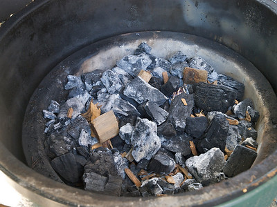 Egg loaded with old and new charcoal and wood chunks and chips
