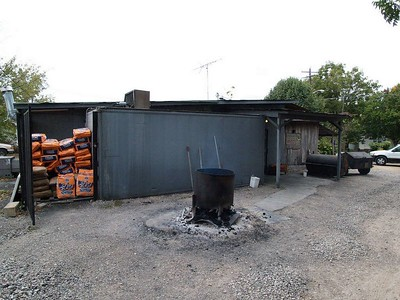 Orange bags contain the lump charcoal that Richard burns down to coals before putting under the meat in his large  BBQ pits