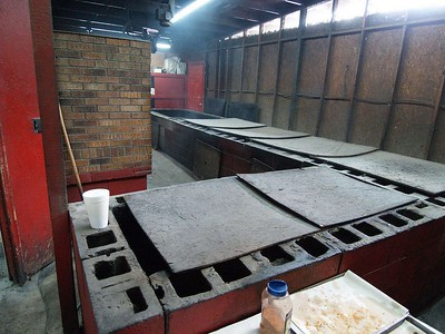 BBQ pits made from cinder block with prticle board on the top