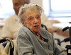 HOLLY PELCZYNSKI - BENNINGTON BANNER Veteran, Rhoda Charron sings along to the music of a barbershop quartet on Thursday afternoon at the Vermont Veterans Home.
