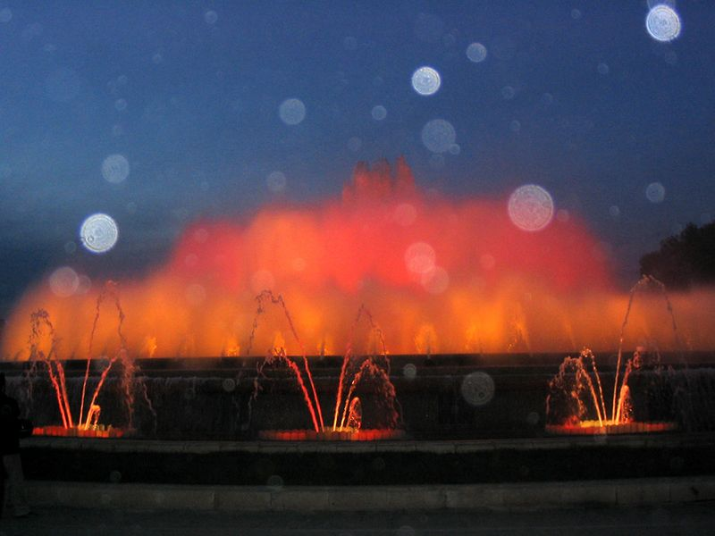 """The Magic Fountain was built in 1929 for the Barcelona World's Fair. After many years of disuse the city restored it for the 1992 Olympic Games. The fountain sprays dancing jets of water, lit by different coloured lights, to the sounds of Mozart, Queen and Whitney Houston. The climax is Freddy Mercury and Montserrat Caballé singing """"Barcelona"""""""