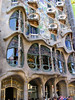 The amazing facade, and tourists queuing to enter. Gaudi totally remodelled the already existing apartment building in 1906-08.