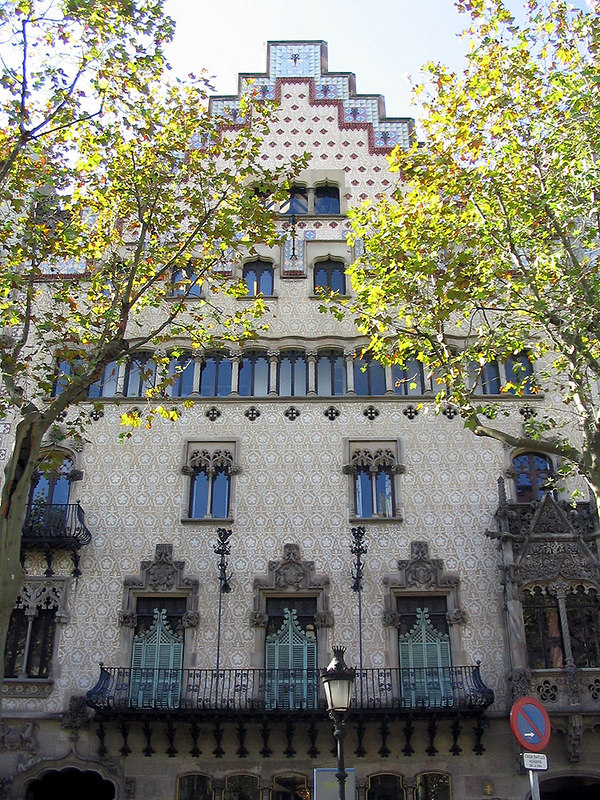 The beautiful, adjacent building is the Casa Amatller, designed by Josep Puig i Cadafalch in 1900