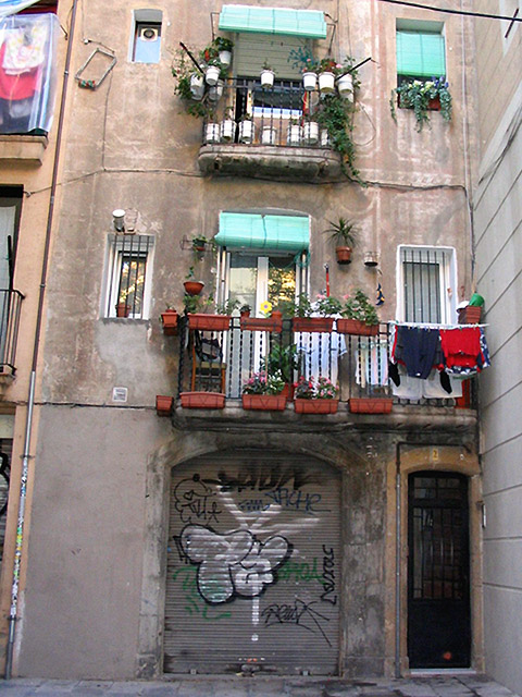 Balconies and graffiti in the street near the museum