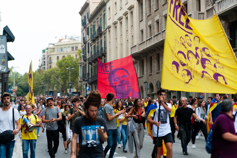 Barcelona, Spain - 14 october 2019: independentists march in laietana streets against the sentencing of catalan leaders holding placards and banners of oriol junqueras
