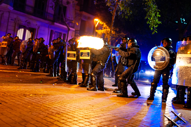 Barcelona, Spain - 17 october 2019: moment a mossos d'esquadra catalan police shoots a rubber bullet at protesters during night riots and clashes for independence