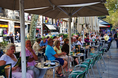 """Part of the attraction of La Rambla is getting a table at one of the outdoor cafes and watching all the people walk by and watching them react to some of the """"human statues""""."""