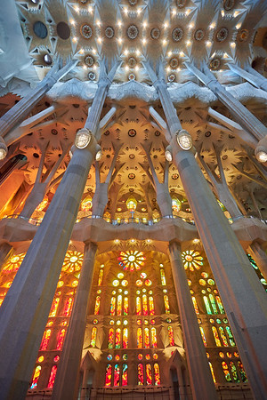 One one side of Sagrada Familia the stained glass windows take advantage of the setting sun, with warm reds, oranges and yellows. The other side refelcts cool morning colours of green and blue